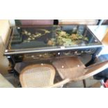 A 102cm late 20th Century chinoiserie style side table with all over decoration on black lacquered