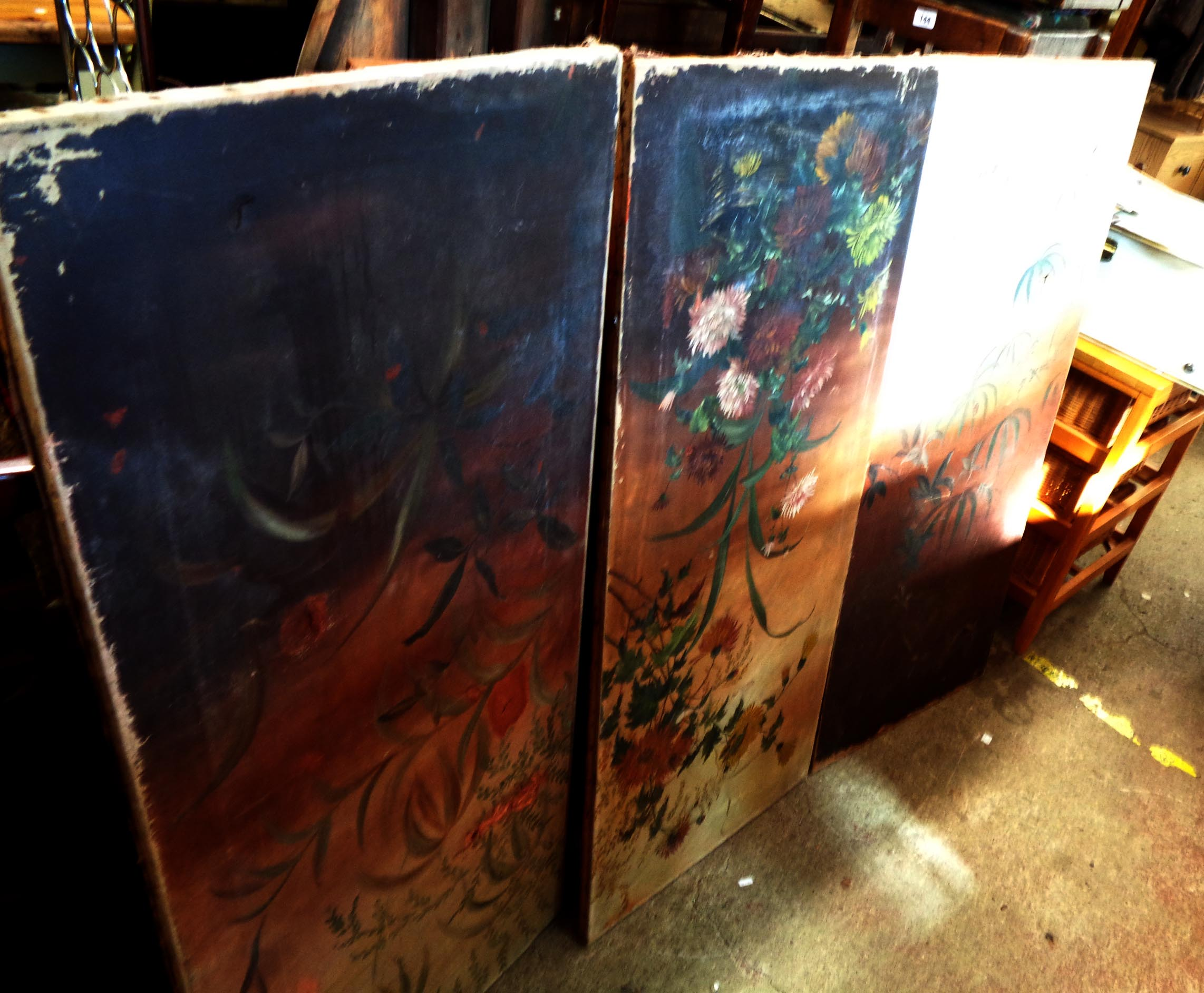 Three late Victorian draught screen panels with remains of hand painted decoration and velvet