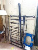 A 1.37m late Victorian painted cast iron double bedstead with brass top rails and finials