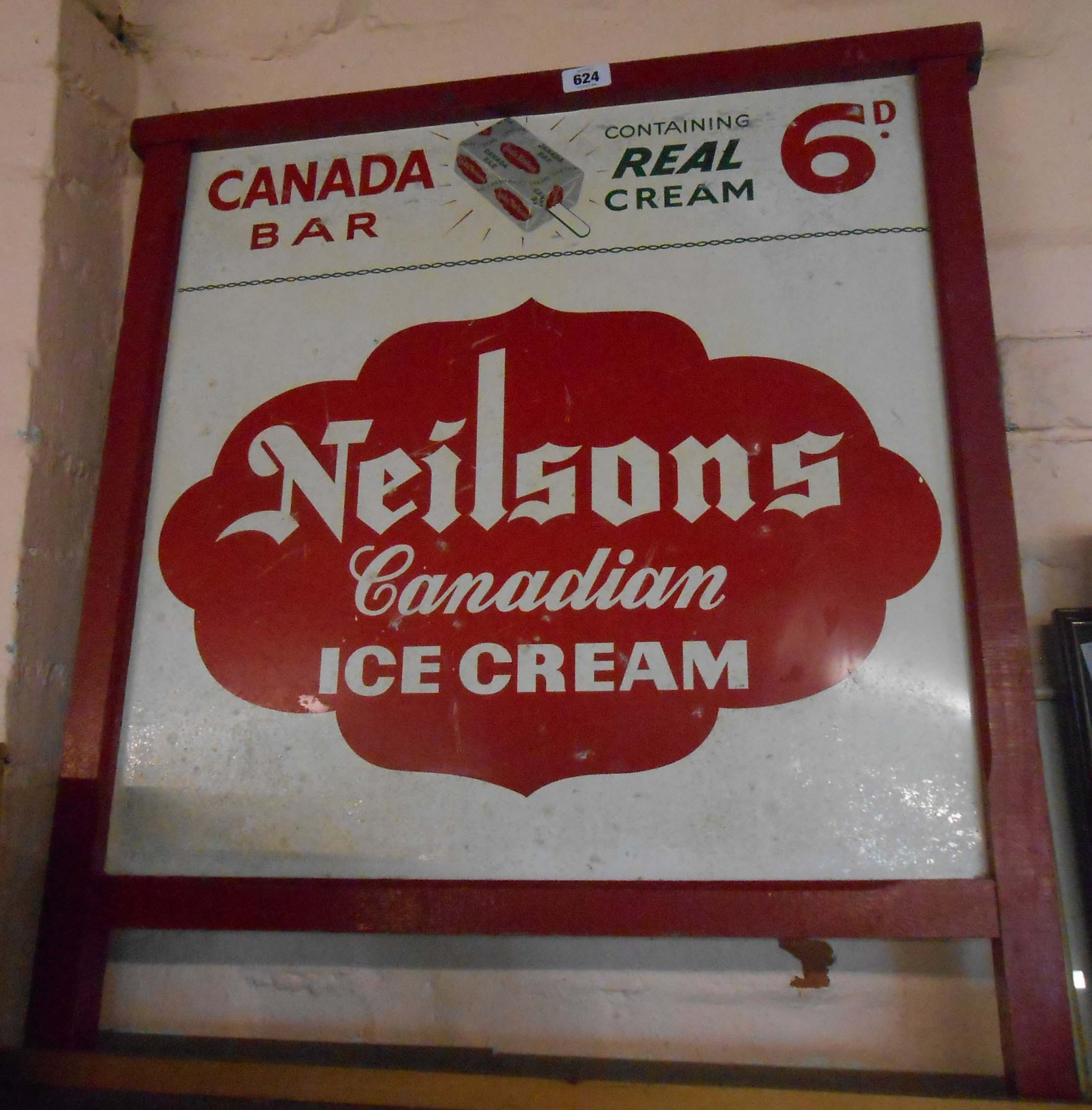 A vintage painted tin advertising sign for Neilsons Canadian Ice cream in original painted wooden