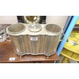 A silver plated two bottle wine cooler with central lidded ice well and flanking handles, set on fan