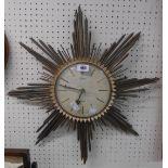 A vintage Selva Electra brassed metal sunburst wall timepiece