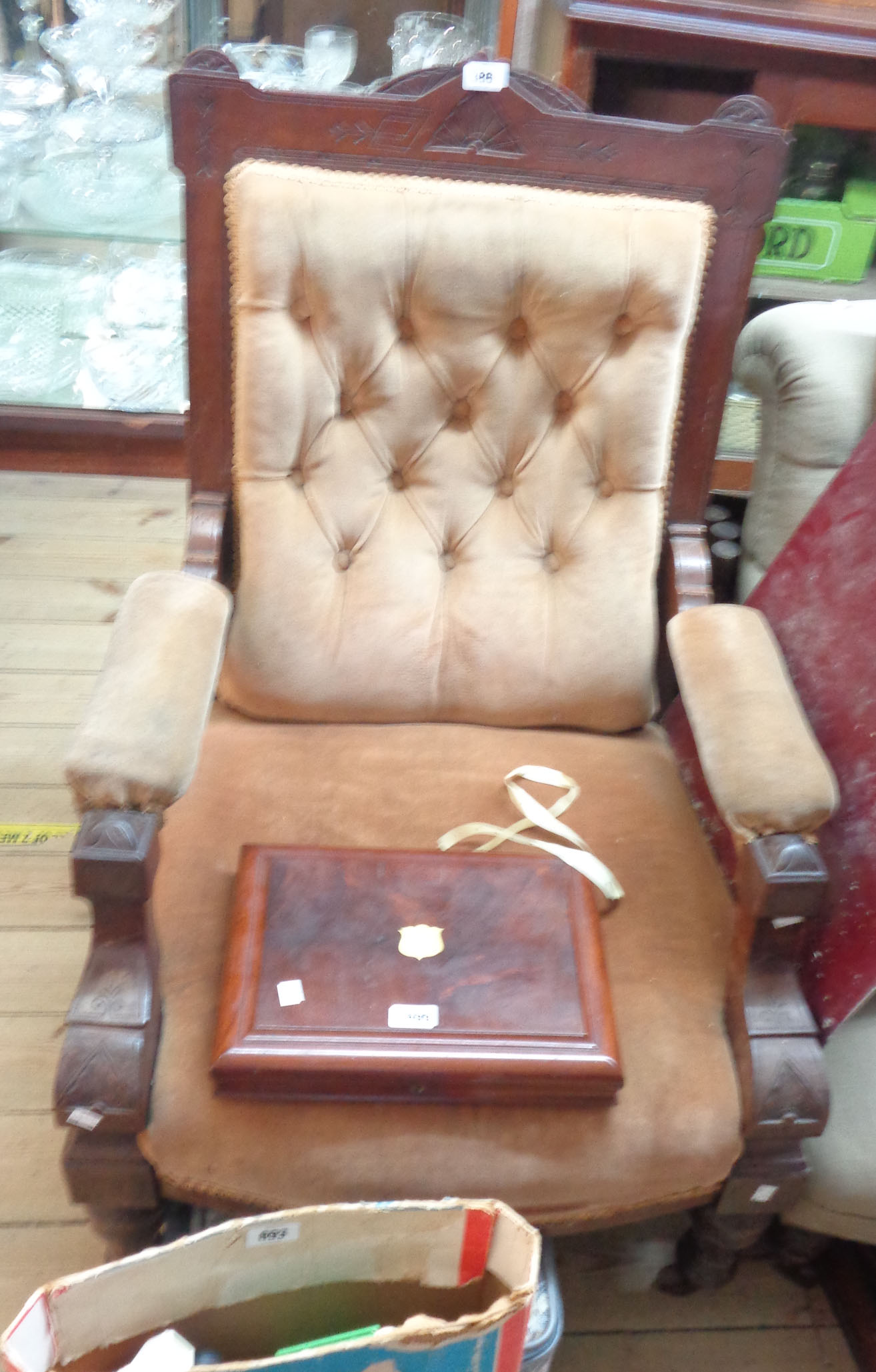 A late Victorian walnut part show frame drawing room armchair with incised decoration and button