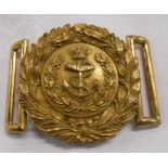A gilt metal Royal Navy belt buckle with double wreath