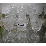A set of six vintage Stuart crystal port glasses with heavily cut decoration - sold with a similar