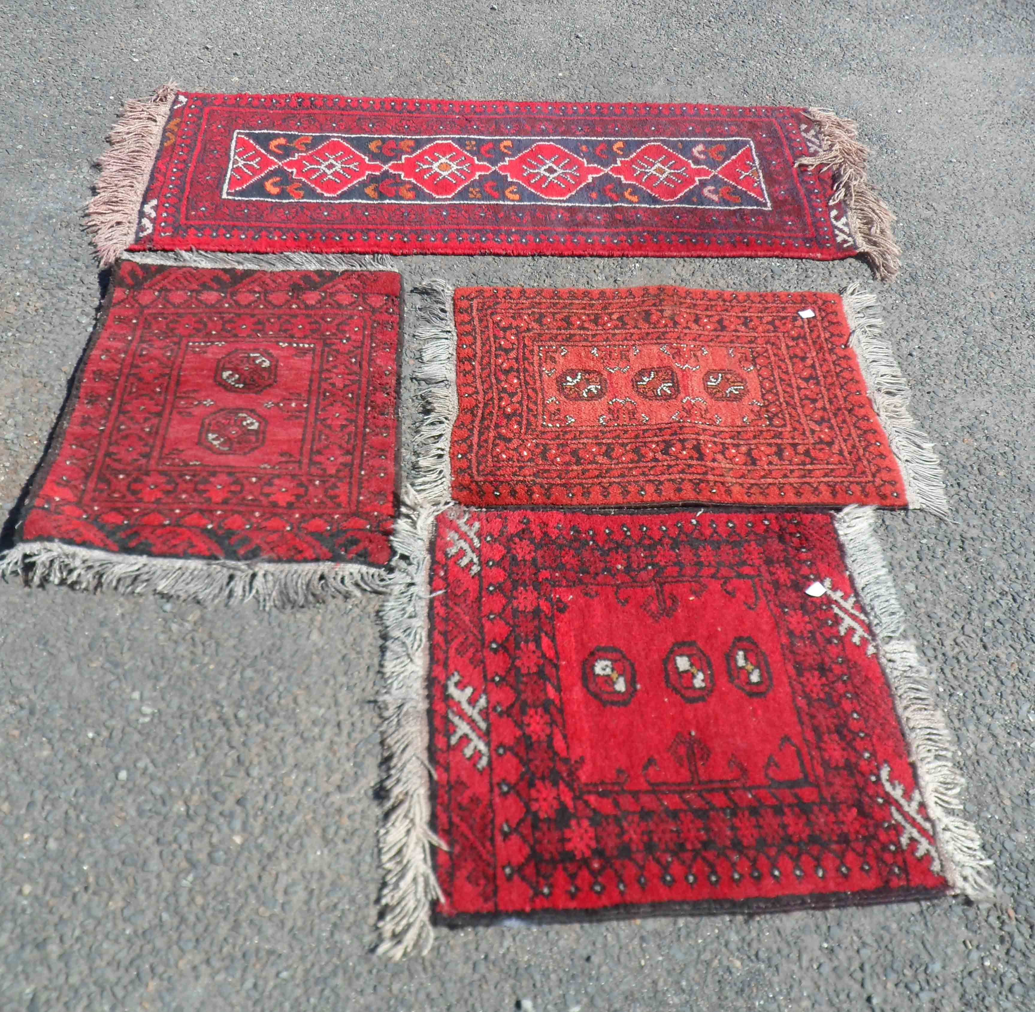 Three Afghan small handmade mats with central guls - sold with a similar North Indian runner mat