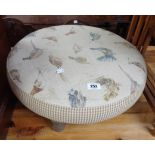 A Voyage Maison circular foot stool with bird decorated upholstery, set on turned legs