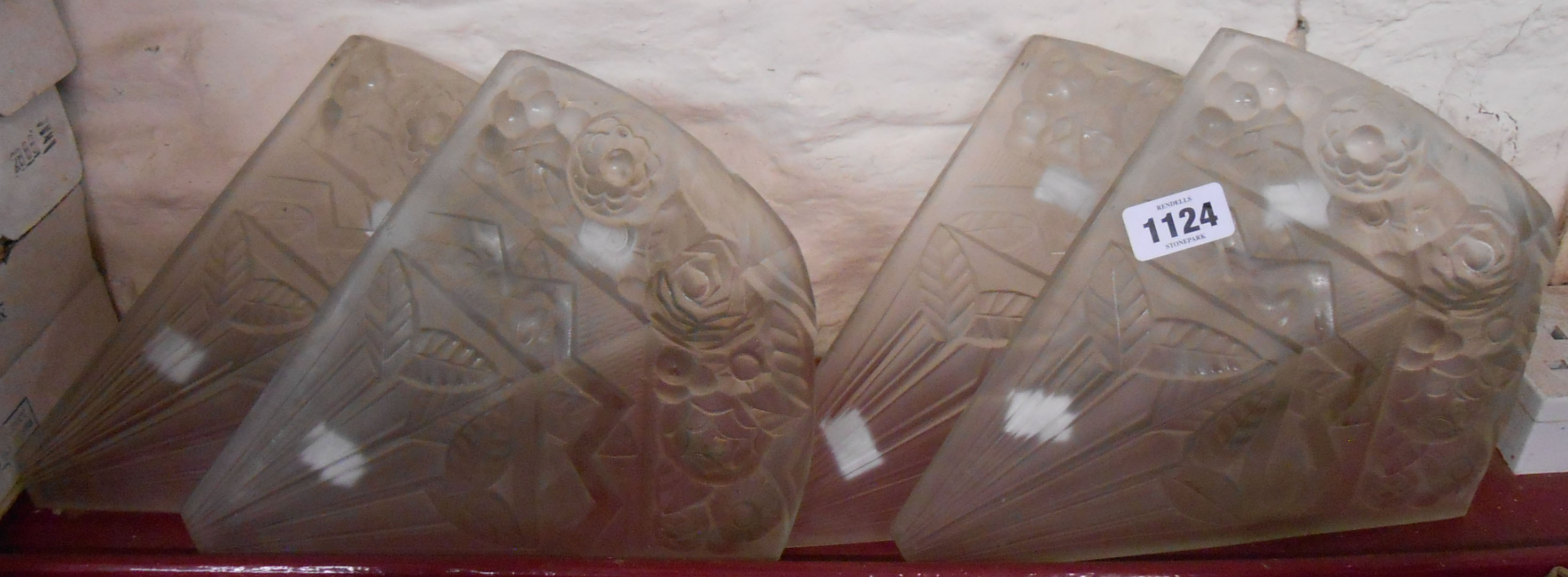 A set of four French Art Deco moulded glass lighting panels with satin finish marked for Noverdy,