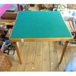 A vintage Vono stained wood folding card table with green baise top