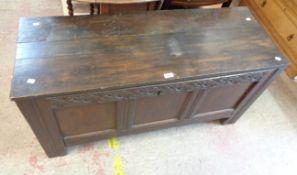 A 1.22m antique oakthree panel coffer A 1.22m antique oak three panel coffer with later top and