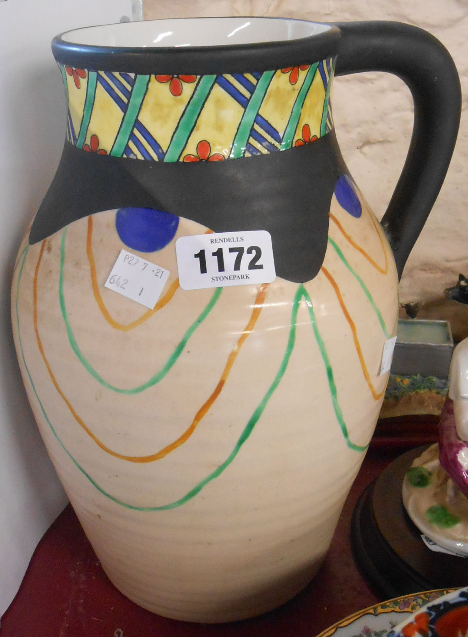 A large Art Deco Wilkinsons pottery jug decorated with a trellis frieze and freeform swagging