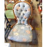 A reproduction part show frame spoon back nursing chair with studded tapestry upholstery, set on