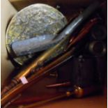 A box containing assorted metalware including copper kettle, hunting horns, pewter measures, etc.
