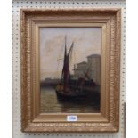 A gilt framed oil on canvas, depicting a fishing vessel in a harbour - signed with monogram,