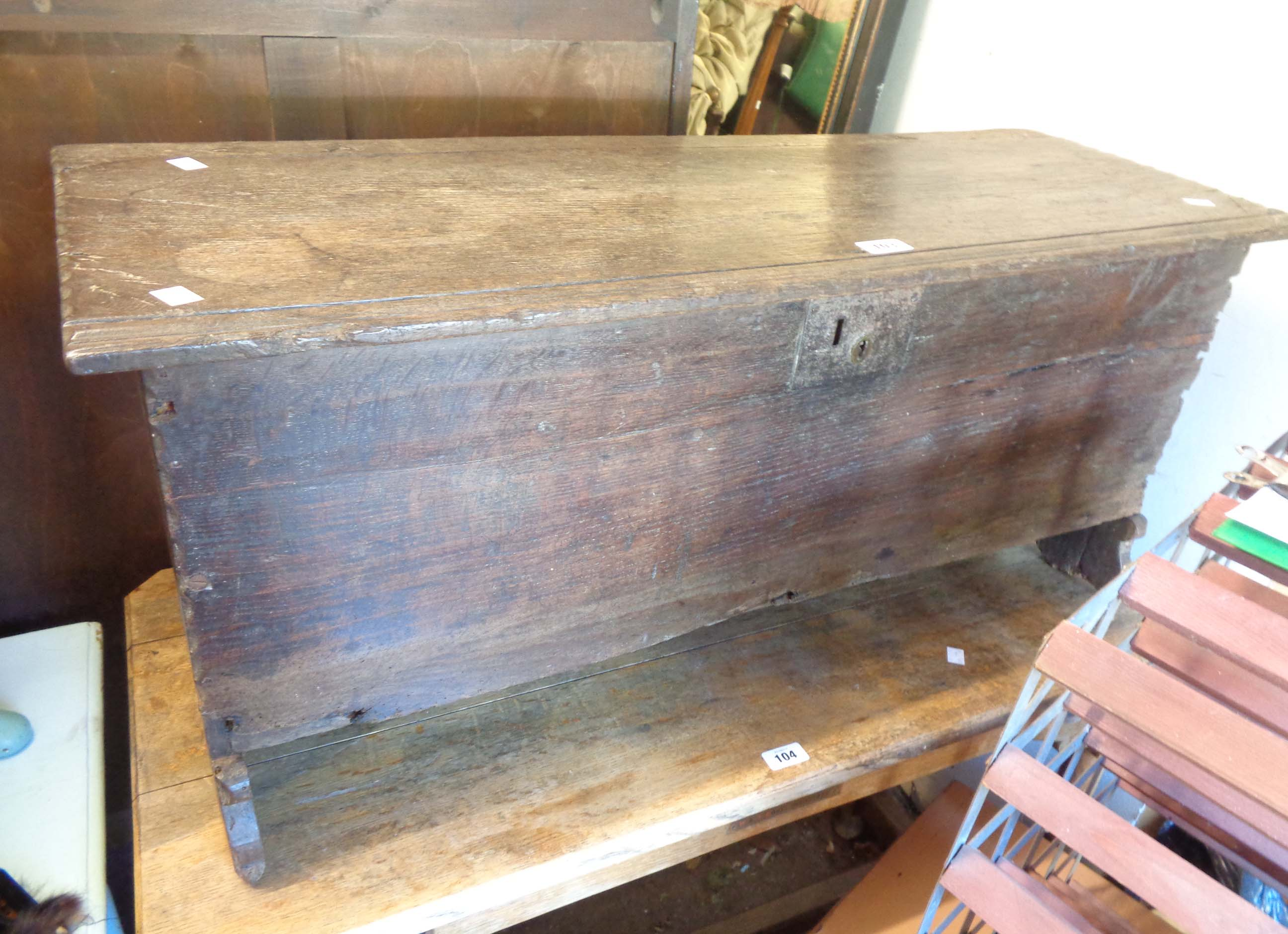 A 97cm 18th Century oak coffer with rivened edges, set on shaped standard ends - candle box missing