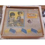 A vintage 1960's Lego system block set in wooden slide top box with quantity of coloured bricks