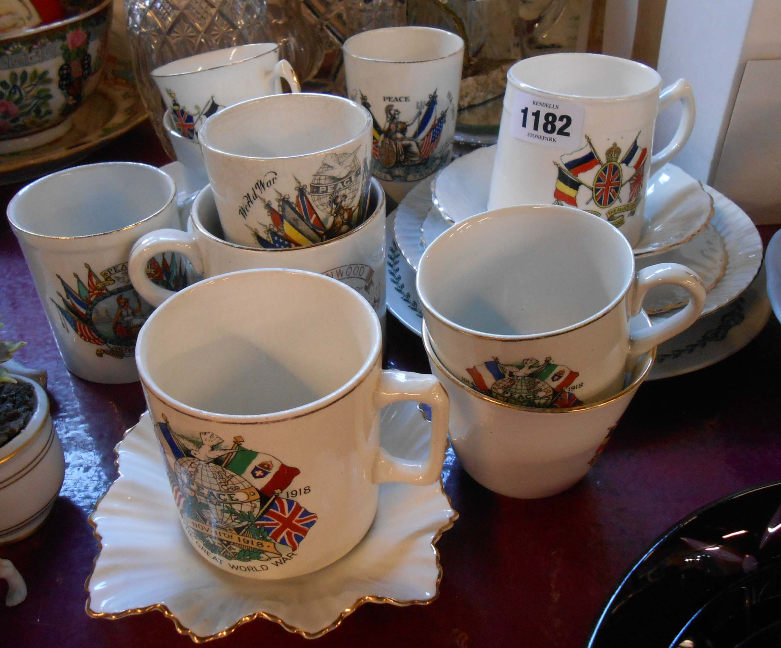 A selection of ceramic items made to commemorate the end of WWI in 1918 including mugs, plates,