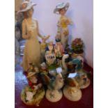 A quantity of assorted ceramic figurines including animals, Capodimonte, Nao, etc.