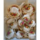 A Royal Albert Old Country Roses tea set comprising large teapot, seven trios, milk and sugar and