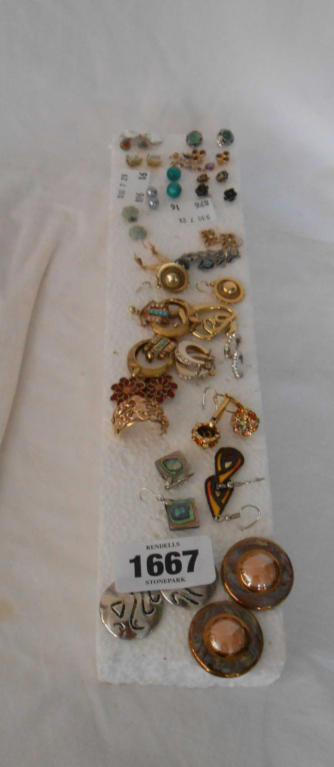 A collection of ear-rings including a pair of 9ct. gold examples