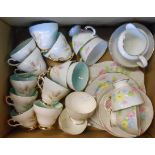 A box containing a Salisbury fine bone china part tea set comprising six trios, milk and sugar,