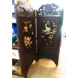 A late 19th Century Oriental ebonised carved wood framed two fold dressing screen with remains of