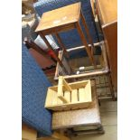 A selection of small furniture items comprising three occasional tables and a trug