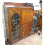 A 1.22m vintage Awl-Lyn stained walnut side by side bureau/bookcase with central fall and cupboard