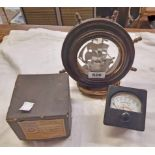 A vintage novelty ship and wheel form table lamp - sold with a vintage voltmeter