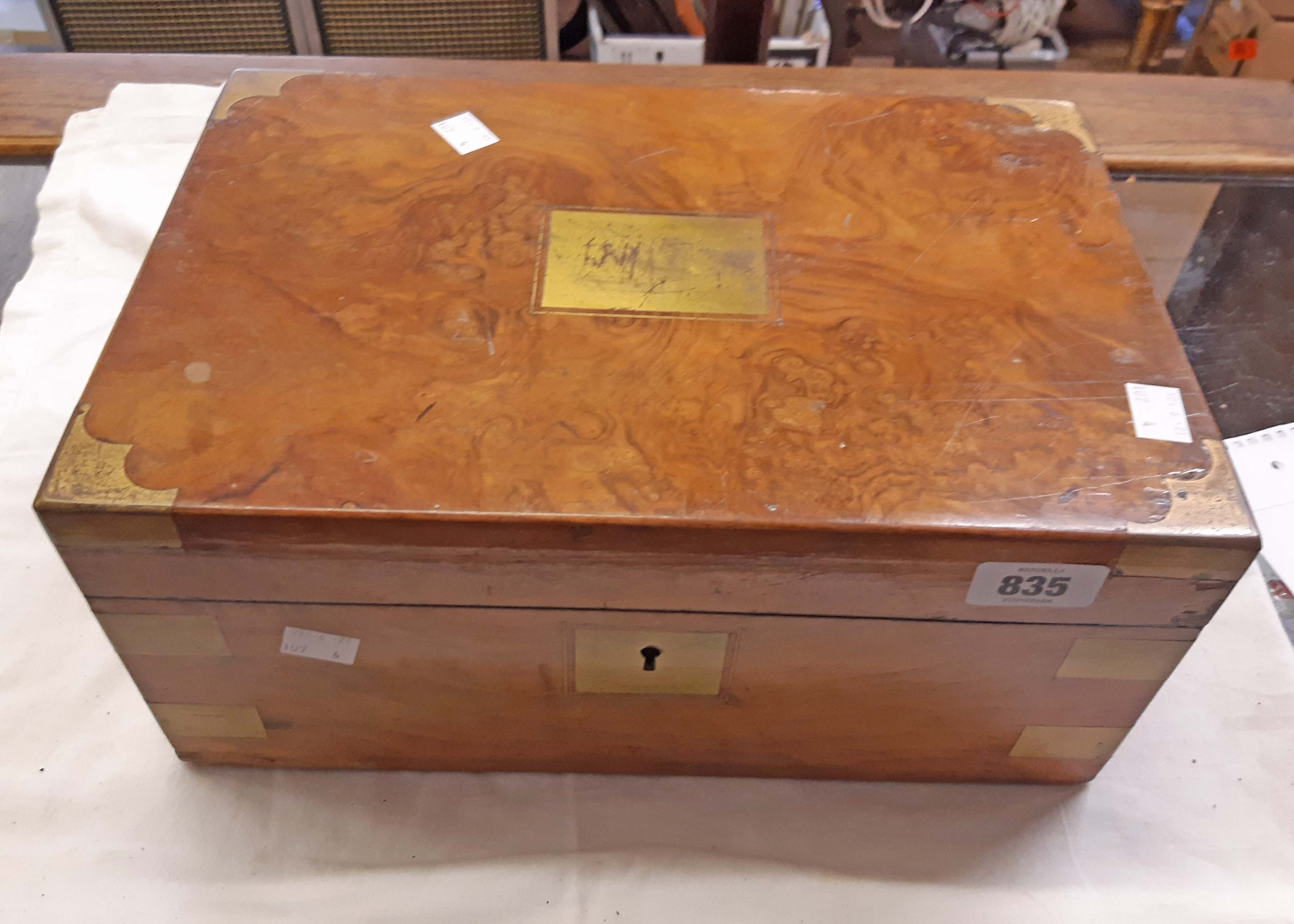 A Victorian burr walnut veneered writing slope with fitted interior and inkwells