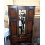 A 100cm early 20th Century polished oak single wardrobe with hanging space enclosed by a mirror