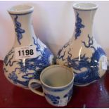 A pair of 20th Century Chinese porcelain bottle vases hand painted with dragons and six character