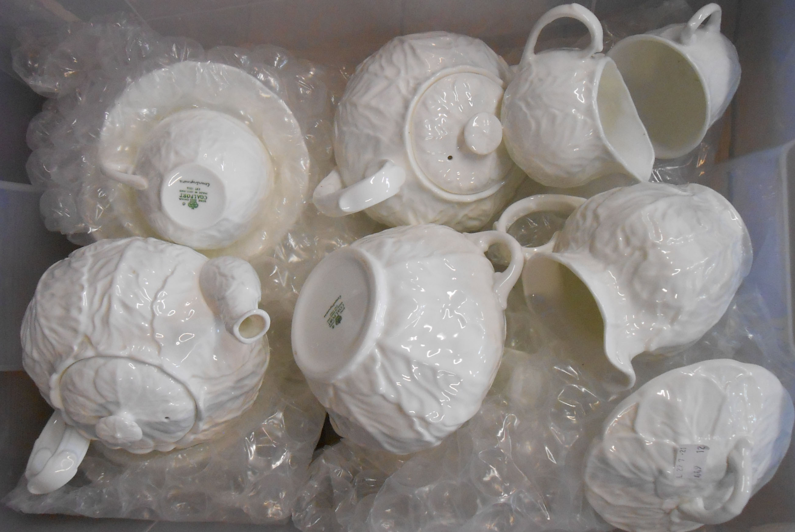 A quantity of Coalport Countryware white gloss cabbage leaf pattern teaware including teapots,