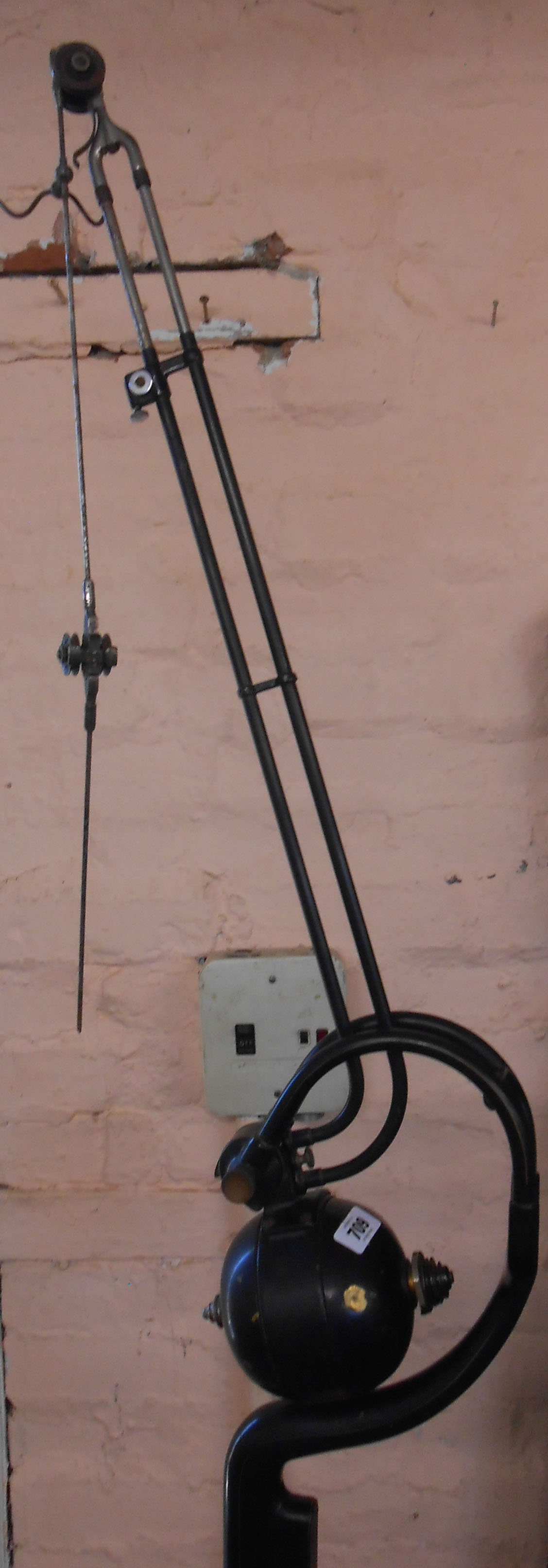 A vintage dentist's drill assembly with cast iron base - later conversion to lamp