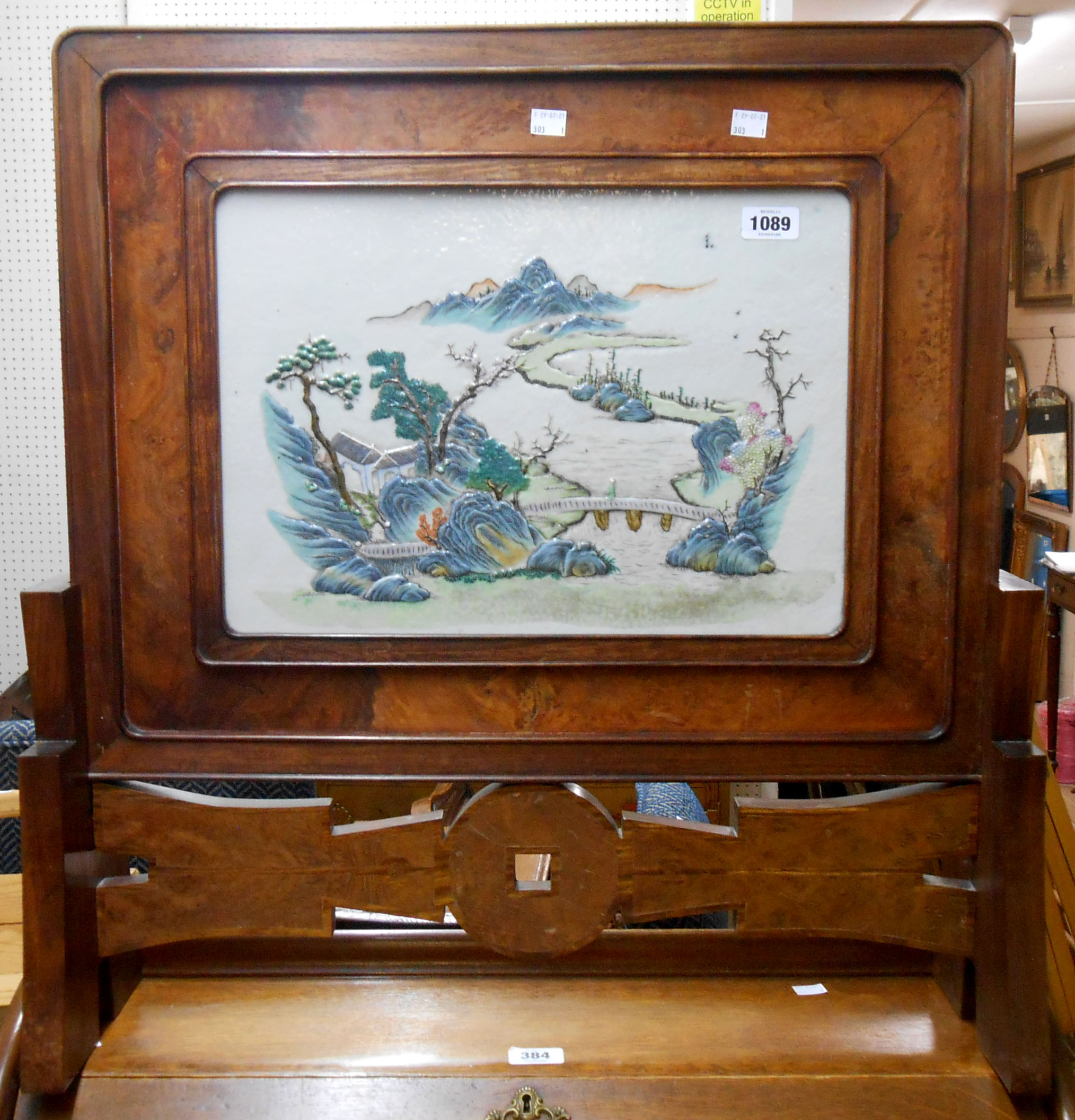 An early 20th Century Chinese table screen with central porcelain panel relief moulded with a - Image 2 of 9
