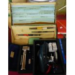 A tin cased stencil kit with cellulose stencil sheets, brushes and inks - sold with a vintage Dymo