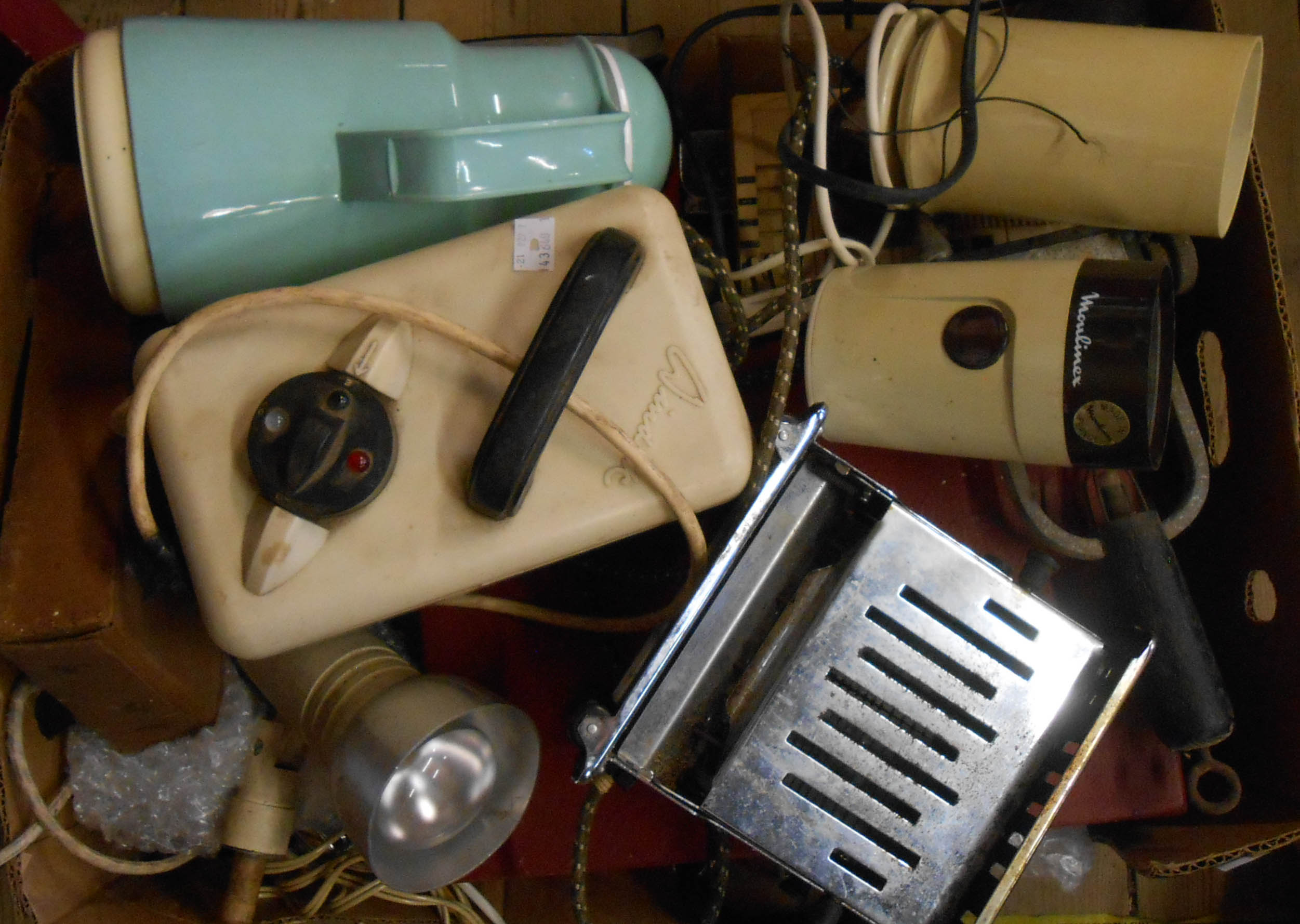 A box containing assorted collectable items including vintage electric razor, battery tester, tape