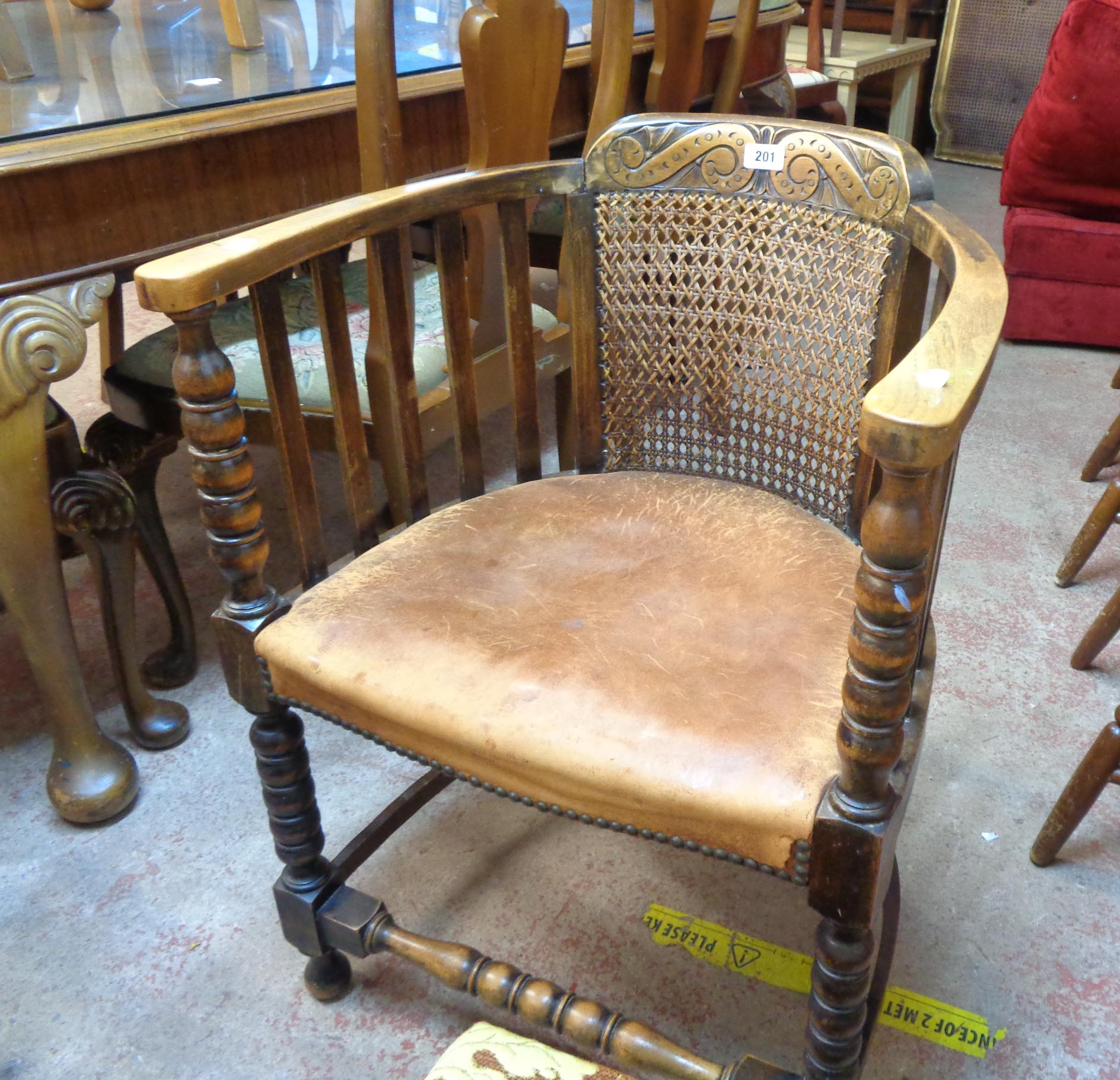 A 1920's oak framed tub elbow chair with remains of studded leather upholstery, set on bobbin turned - Image 2 of 4