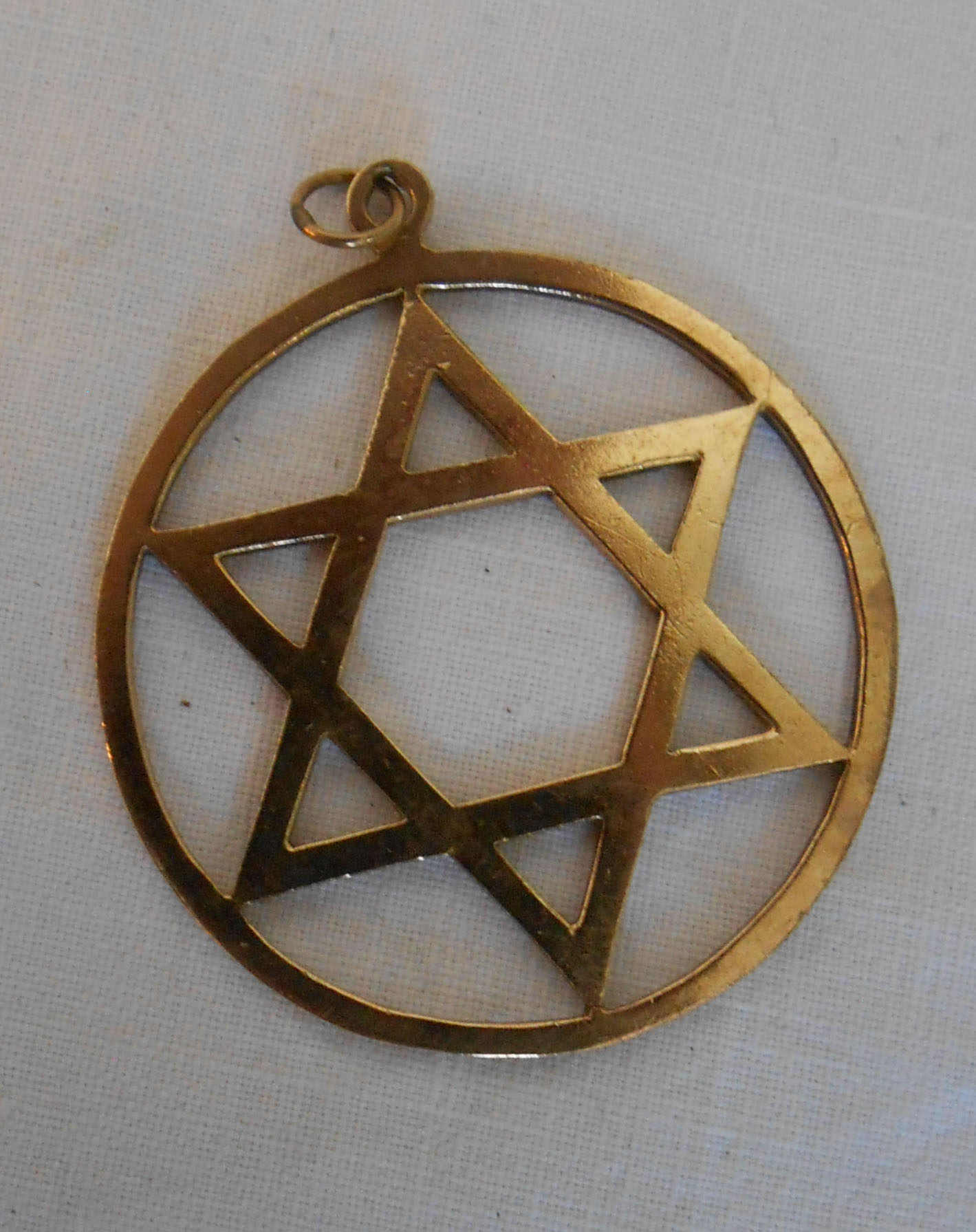 A hallmarked 9ct. gold star of David pendant