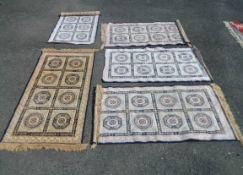 Five similar 20th Century machine made Belgian mats