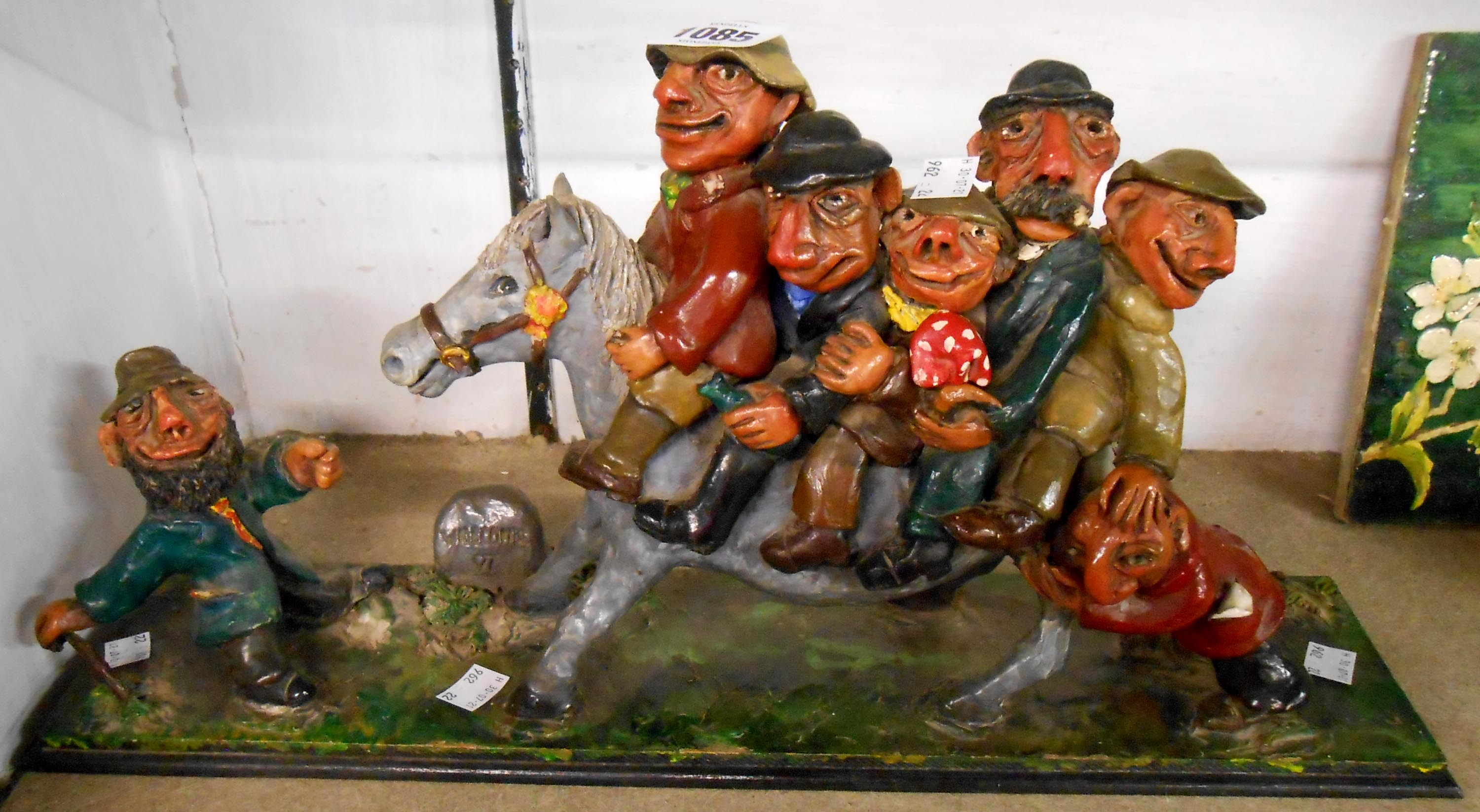 A vintage hand built modeller's clay figurine depicting a scene from Widecombe Fair