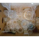A box containing assorted glassware including vases, bowls, drinking glasses, etc.