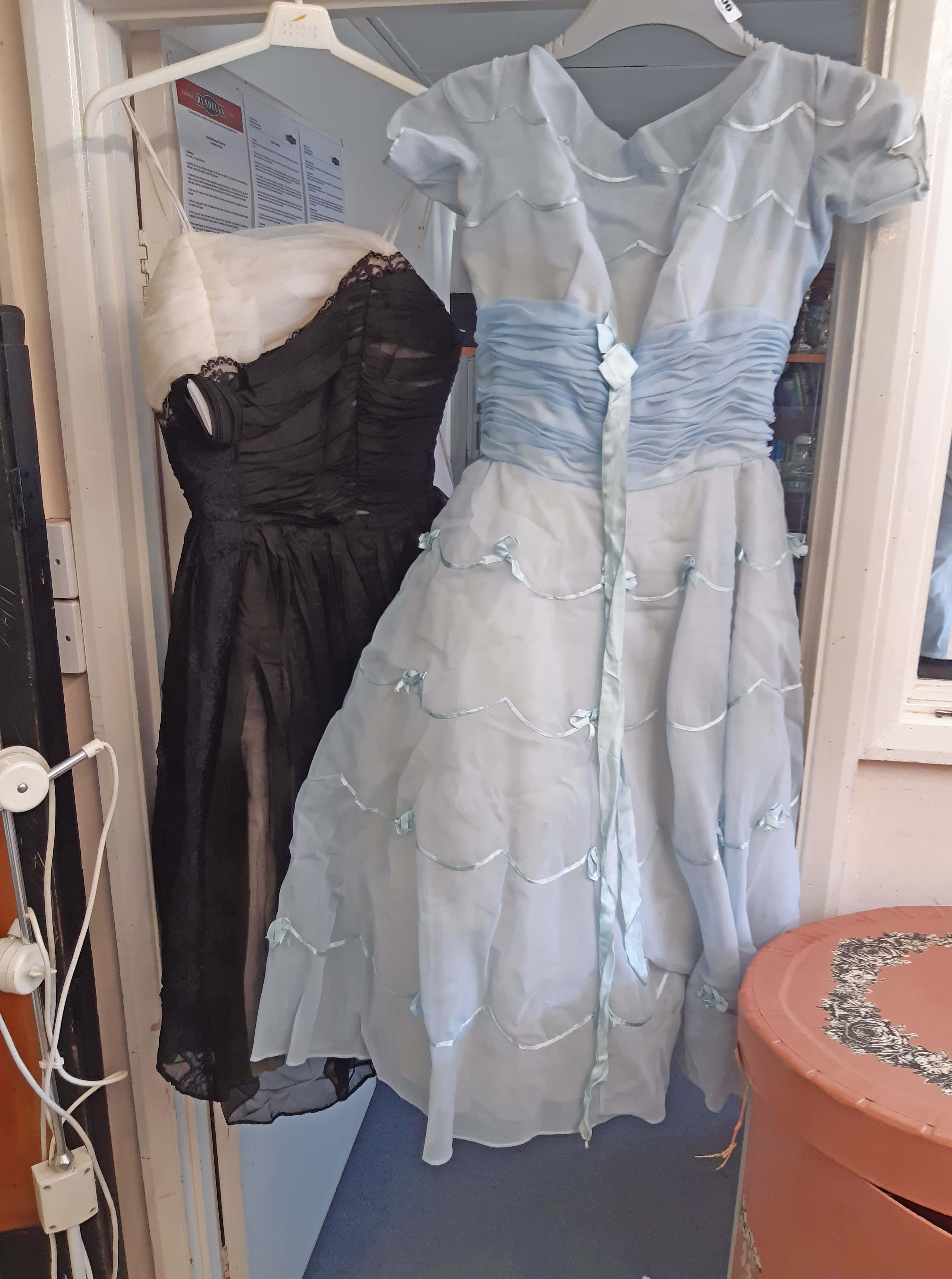 A vintage black and white organza cocktail dress with ruched bodice and gathered skirt with lace
