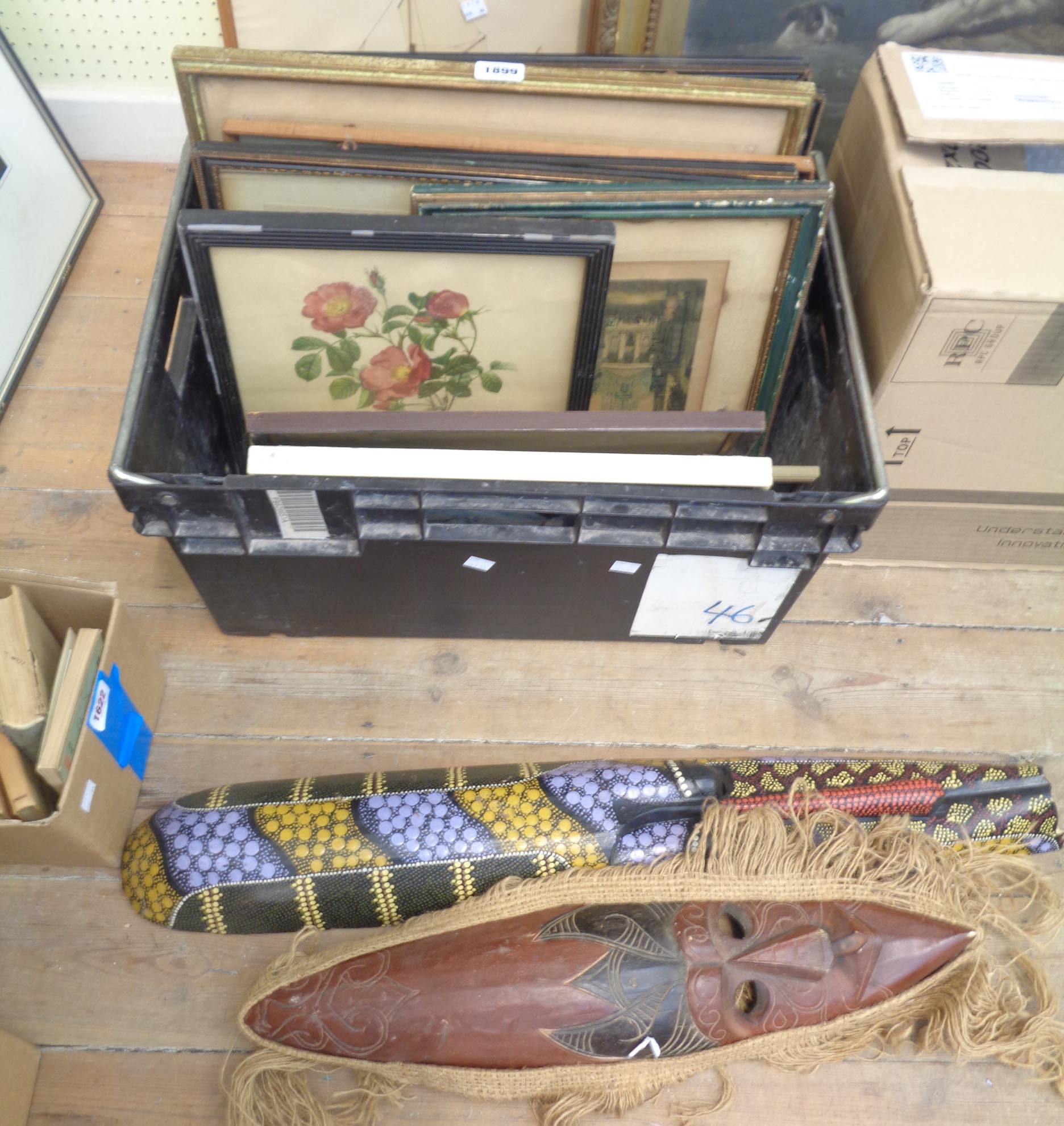 A crate containing assorted pictures and prints including various Hogarth framed monochrome