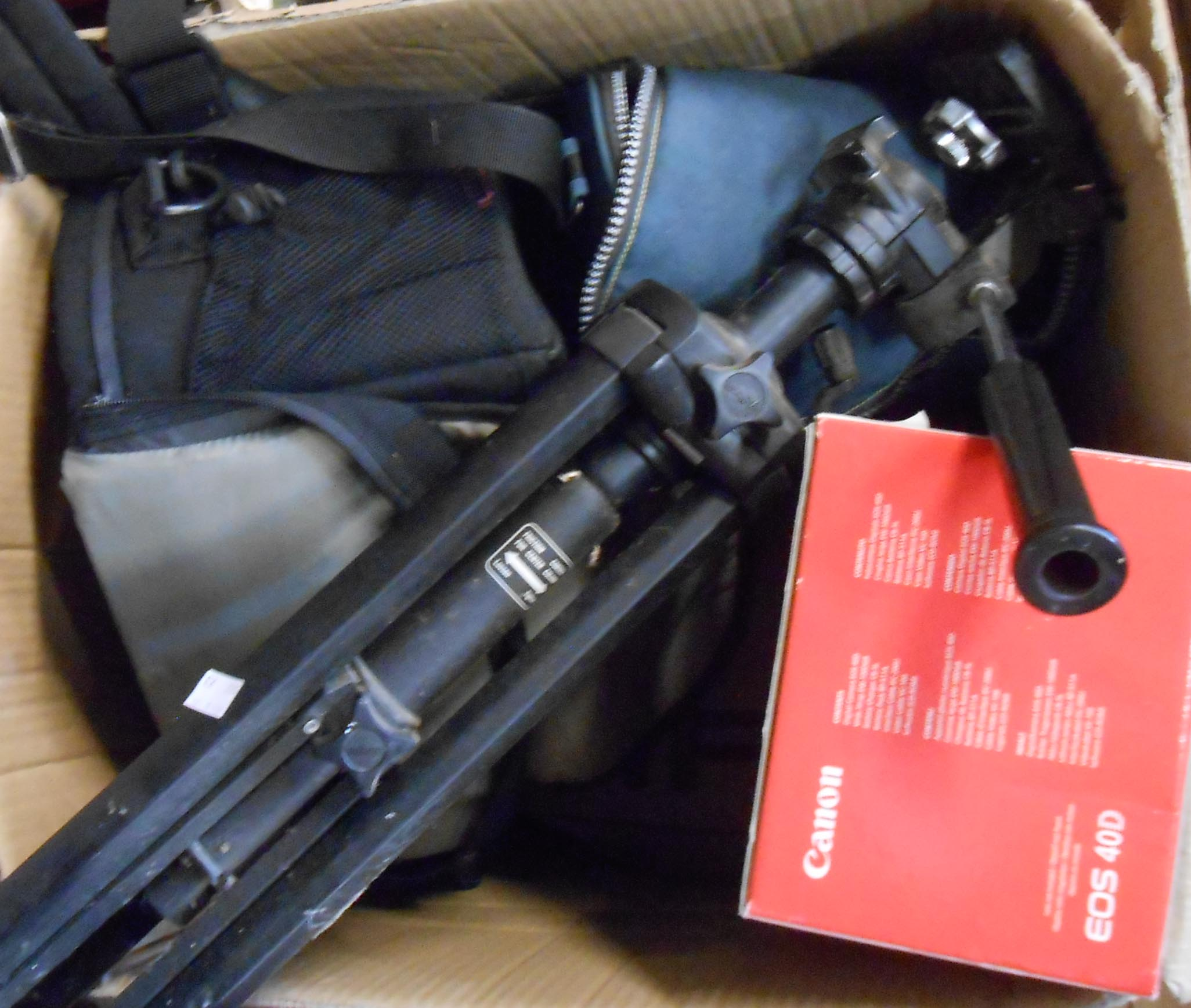 A box containing assorted cameras and equipment including Canon EOS 40D with Sigma 200mm lens, a