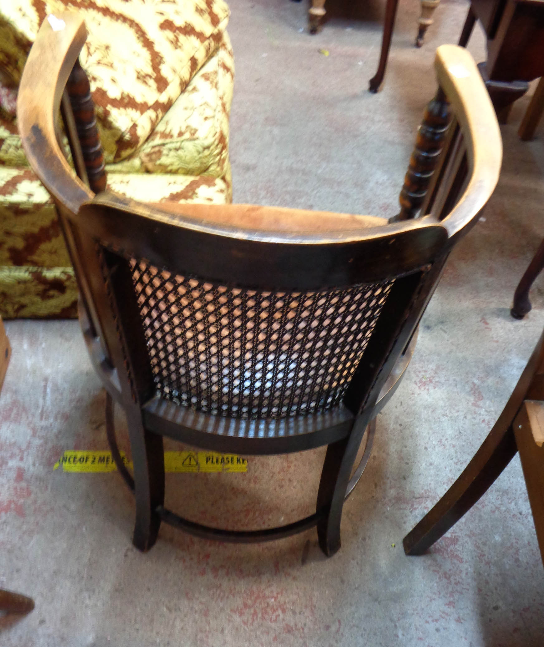 A 1920's oak framed tub elbow chair with remains of studded leather upholstery, set on bobbin turned - Image 4 of 4