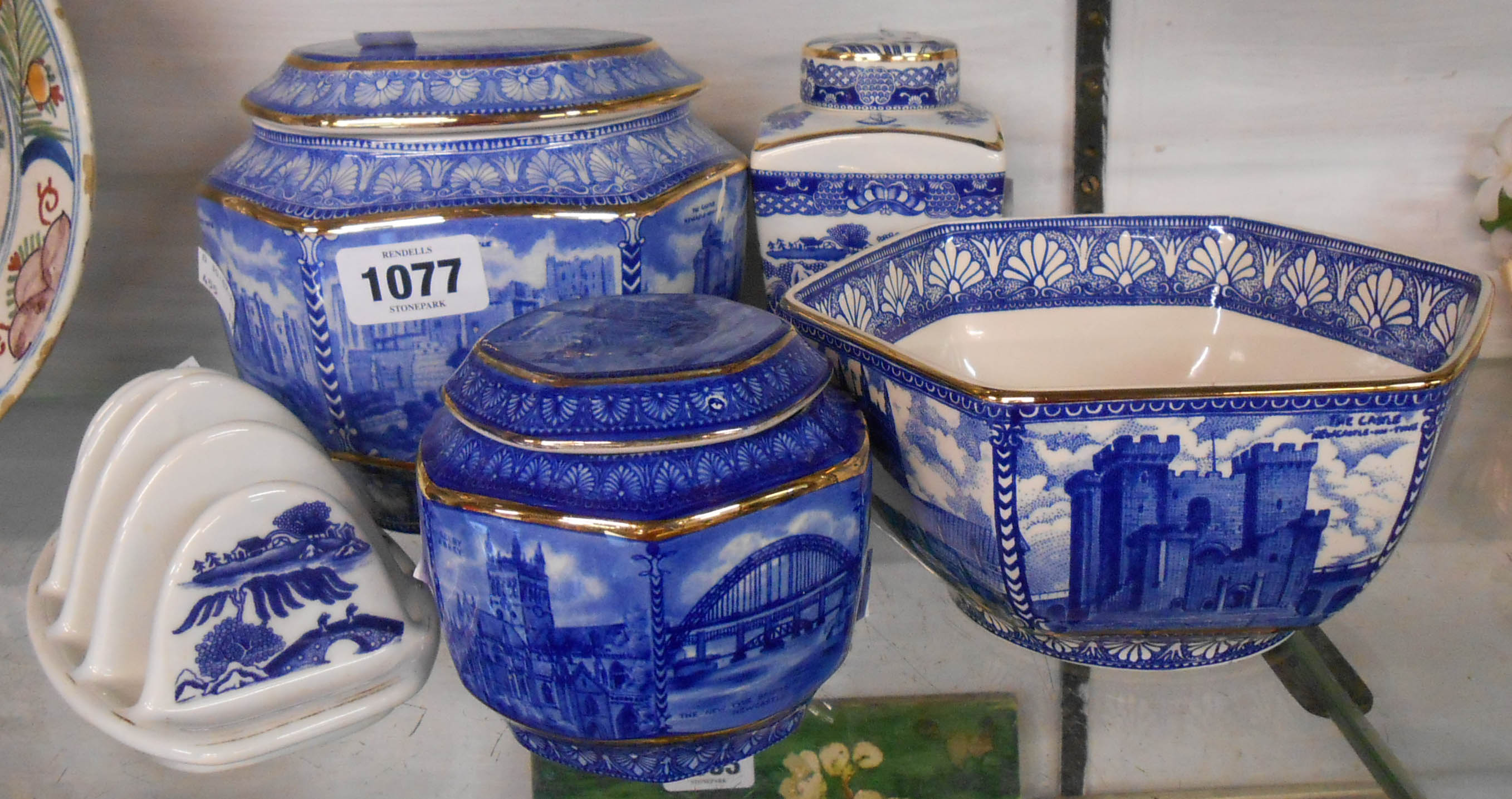 Five pieces of 20th Century blue and white Wade pottery made for Ringtons Tea to commemorate the