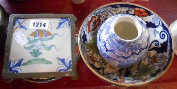 An old Delft tile in a pewter teapot stand frame - sold with another teapot stand and an Amherst
