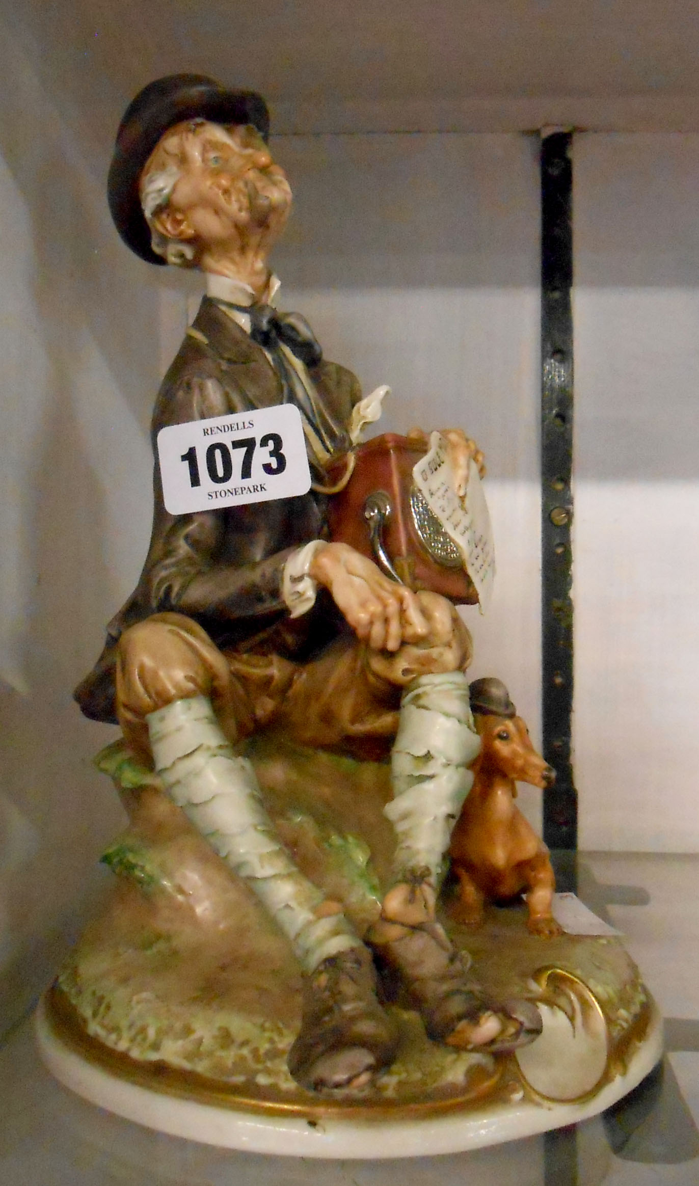 A vintage Capodimonte G. Cappe figurine of a hurdy gurdy man