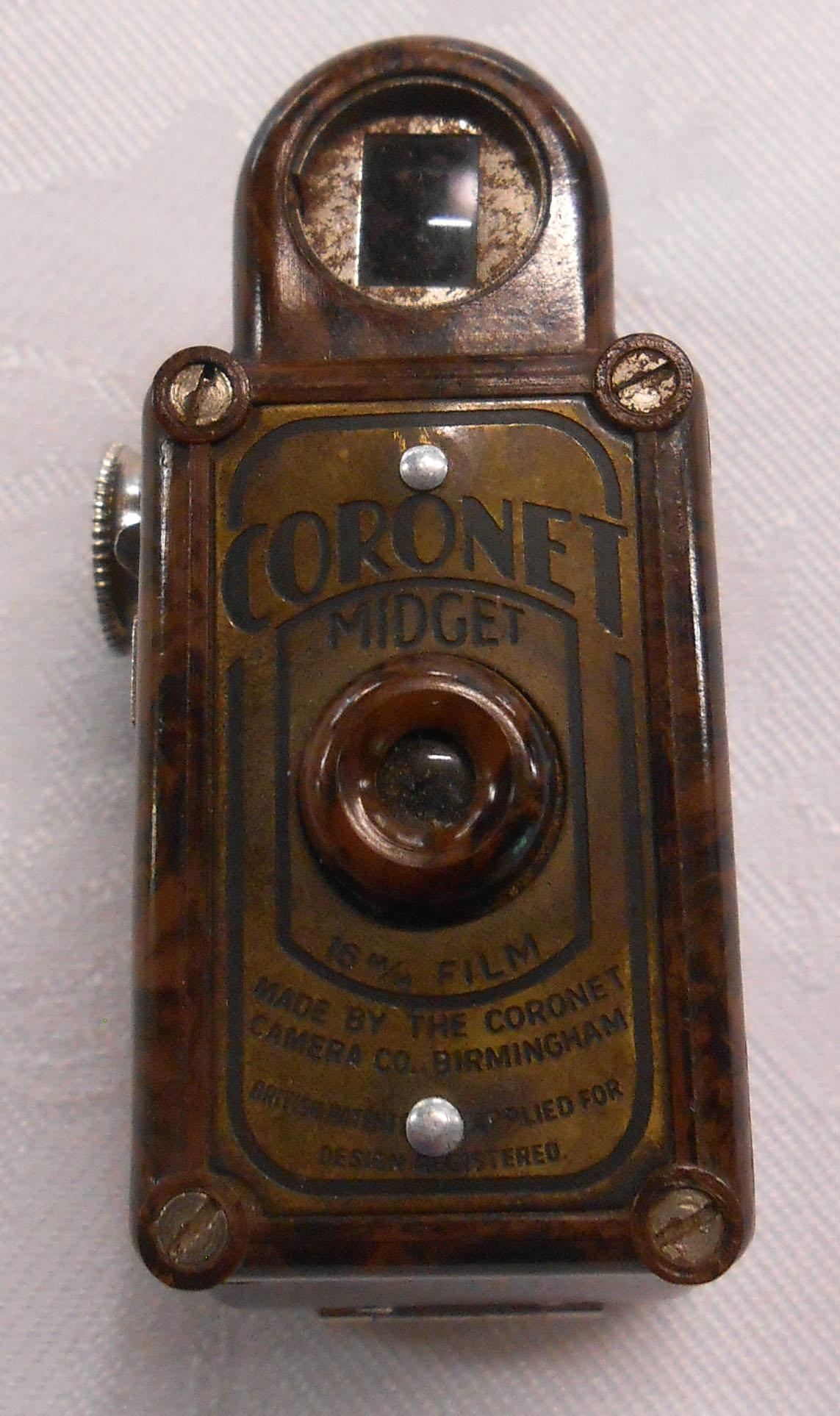 A vintage Coronet Midget miniature camera with brown Bakelite case